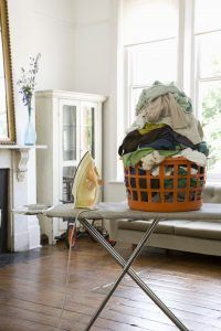 Laundry basket on ironing board